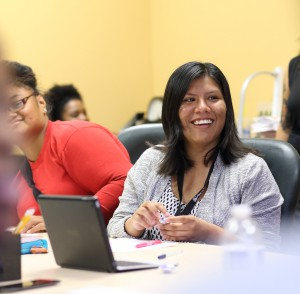 Sahara Estrada Hernandez is all smiles as she works on her résumé during a guest workshop by San Diego Workforce Partnership's CONNECT2Careers program.