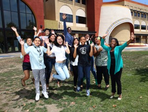 YES students jump for joy after reaching their collective goal of obtaining 1,000 completed surveys!